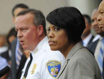 Baltimore Mayor Stephanie Rawlings-Blake and interim Police Commissioner Kevin Davis announce the start of the Baltimore Federal Homicide Task Force this week.