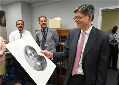 Former Treasury Secretary Jacob Lew looking at a rendering of Harriet Tubman during a visit to the Bureau of Engraving and Printing in Washington, DC on April 21, 2016.