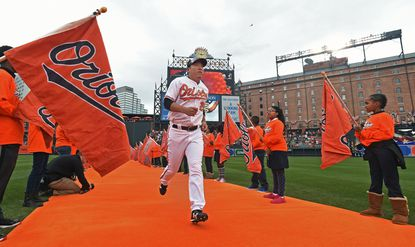 Orioles' Hyun Soo Kim runs in from center field after introduction during the pregame ceremony on Opening Day at Camden Yards on April 4, 2016.