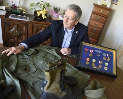 Vietnam veteran Nick Prevas displays his uniform and the medals he received while serving at his home in Highland. Prevas is one of more than 100 veterans participating in a three-hour documentary airing on Maryland Public Television this month.