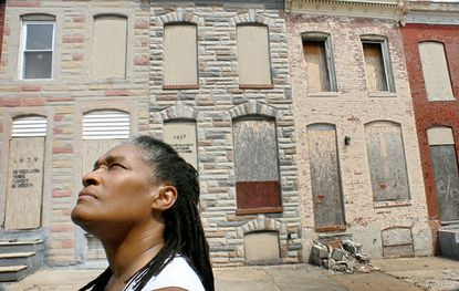 Doris Minor-Terrell, president of the Rutland Lafayette Community Association, looks at vacant houses.