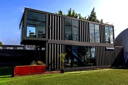 This two-story Los Angeles home was constructed from surplus shipping containers. A more modest, one-story design has been proposed by a philanthropic couple addressing the need for affordable housing in Baltimore.