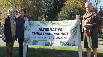 United Methodist Women Barb Moore, Lisa Niemann and Mary Conklin, each wearing a fair-trade scarf, host the Alternative Market this weekend at Davidsonville United Methodist Church. Proceeds from the event will benefit the YWCA's Arden House.
