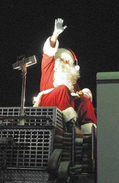 From his perch atop an Arbutus Volunteer Fire Department's fire engine, Santa Claus waved to the crowd that greeted his arrival in Arbutus last year.