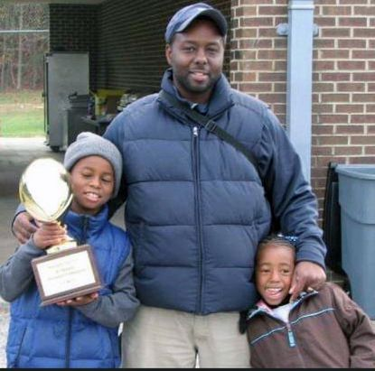 Bernard Richardson, Coach Shallah to many young Baltimore football players, is shown here with his children, King and Queen Richardson, after winning a 2009 national championship. Last month, Richardson was stabbed to death, becoming the city's 300th homicide victim.