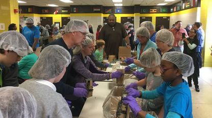 Volunteers prepare meals Saturday for needy students at Reisterstown Elementary School and other schools and shelters for the homeless.