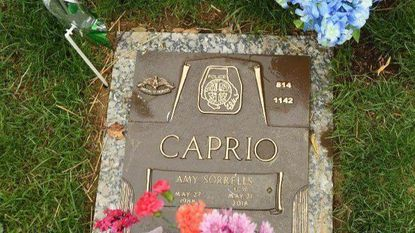 Flowers are seen placed at the grave marker for fallen Baltimore County Police officer Amy Caprio during the Fallen Heroes Day Memorial Service held at Dulaney Valley Memorial Gardens on Friday, May 3. The 34th annual such event in Maryland honors the lives of firefighters, police and other rescue personnel killed in the line of duty.