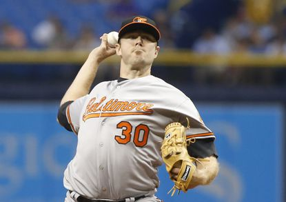 Orioles starter Chris Tillman pitches during the first inning against the Tampa Bay Rays on April 27, 2016 at Tropicana Field in St. Petersburg, Fla.