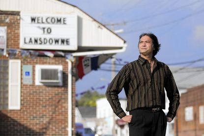 The Lansdowne Inn's new owner, area businessman George Panchigar, poses outside of his restaurant on Hammonds Ferry Road.