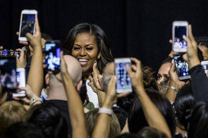 Former first lady Michelle Obama prepares to take the stage during a When We All Vote rally at Chaparral High School in Las Vegas.