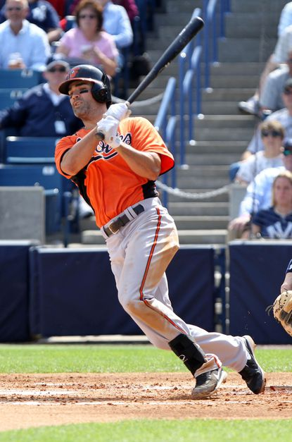 Conor Jackson singles against the Yankees in a Grapefruit League game in Tampa.