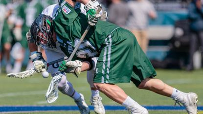 Following in the footsteps of older brother Graham, Bailey Savio (#28, pictured here in Tuesday's 11-8 win at Georgetown) has emerged as the primary faceoff specialist for the No. 10 Loyola Maryland men's lacrosse team.