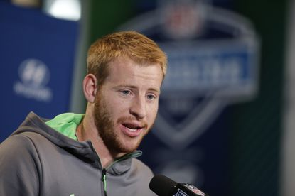 North Dakota St. quarterback Carson Wentz responds to a question during a news conference at the NFL football scouting combine Thursday, Feb. 25, 2016, in Indianapolis.