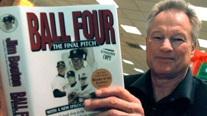 """Former major league pitcher Jim Bouton signs copies of his book, """"Ball Four: The Final Pitch,"""" on November 27, 2000, in Schaumburg, Ill."""