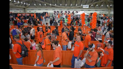 Fans stand in line, awaiting autographs during the annual Baltimore Orioles FanFest at the Baltimore Convention Center.