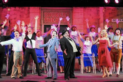 "Cast of ""The Producers,"" featuring, from left front, Pete Thompson, Andrew Gordon, Nathan Bowen, B. Thomas Rinaldi, Erica Miller and Josh Mooney. The show continues through Set. 4 at Annapolis Summer Garden Theatre."