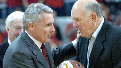 Then-Maryland coach Gary Williams receives a commemorative basketball from former Terps coach Lefty Driesell on Feb. 11, 2006, in College Park. Williams became Maryland's men's basketball coach with the most victories, passing Driesell, with 349 wins.