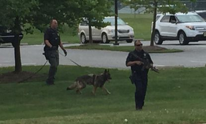 Police officers patrol near the east entrance to Harford Community College after receiving reports of person with a firearm on the camputs on Saturday, June 17.