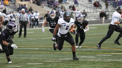 Running back Stuart Walters carries the ball for Johns Hopkins in its 28-20 loss to Mount Union in the 2018 NCAA Division III football semifinals.