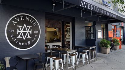The exterior of Avenue Kitchen and Bar photographed in September. The space is being renovated and a second bar is being added to the street-level of the restaurant.