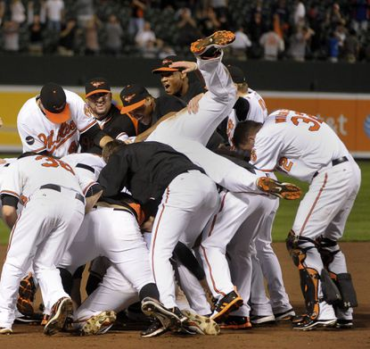 The Orioles celebrate their walk-off victory over the Red Sox on the final night of last year's regular season. The win was also cause for celebration for the Tampe Bay Rays, who came back to beat the Yankees and claim the AL wild card.