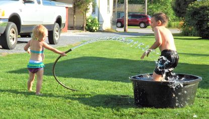 Fun with the hose on the Fourth of July.