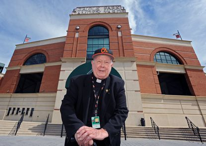 The Rev. John Bauer became chaplain to the Baltimore Orioles in 2004.