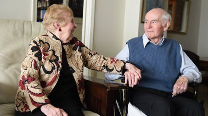 Edenwald residents David and Phyllis Ross holds hands and laugh as they talk about their 66 years of marriage at the community in Towson on Thursday, Feb. 8.