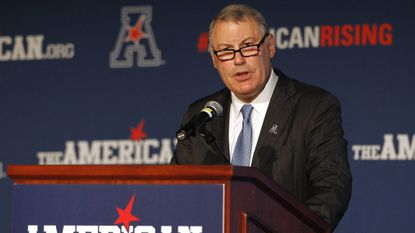 American Athletic Conference Commissioner Mike Aresco, addresses the media during an NCAA football media day in Newport, R.I., Tuesday, Aug. 4, 2015. (AP Photo/Stew Milne)