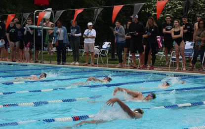 Swimmers compete in the backstroke during the Howard County Invitational Swim Meet at Stevens Forest Pool on June 12.