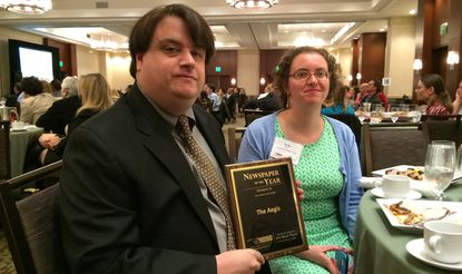 Aegis reporters David Anderson and Bryna Zumer are photographed with the 2014 Newspaper of the Year Award their paper received Friday from the Maryland, Delaware, DC Press Association. The award recognizes top reporting, writing, photography and web content among the region's non-daily publications with a circulation of more than 20,000.