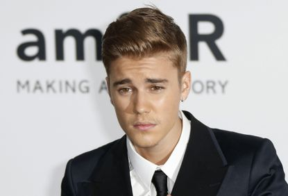 Justin Bieber, pictured at a May fundraiser held during the Cannes Film Festival, apologizes for making a racist joke.