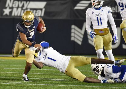 Navy quarterback Xavier Arline picks up a first down against Tulsa on Dec. 5 at Navy-Marine Corps Memorial Stadium. Navy's 2021 schedule includes six home games.