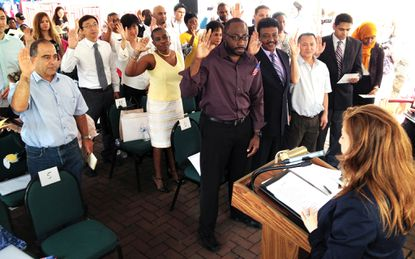 Immigrants from 29 nations take the Oath of Allegiance for Naturalized Citizens on July 4.