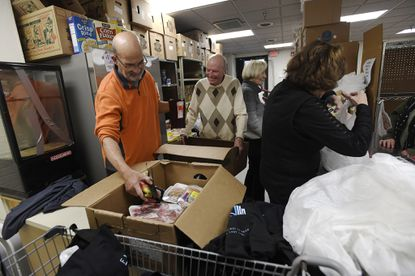 Volunteers, from left, Brian Alles, Steve Hollands, Sue Bridges and Sue Schaefer fill an order for a client at Carroll County Food Sunday in Westminster Thursday, Nov. 21, 2019.