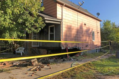 Two people died after their car crashed into the house while the vehicle was being pursued by police in Detroit. The car burst into flames Tuesday, Sept. 8 and blew a huge hole in the foundation of the house. Police say three other people in the car were in critical condition.