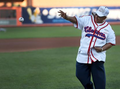 """In this file photo, Mamie """"Peanut"""" Johnson, former pitcher for the Indianapolis Clowns 1953-55, throws out the ceremonial first pitch during a 2015 IronBirds game at Ripken Stadium."""