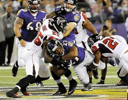 Running back Ray Rice is stopped during the first half of the Ravens' preseason home opener against the Atlanta Falcons at M&T Bank Stadium in Baltimore Thursday.
