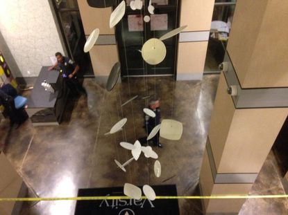 Officers tape off the lobby of the interior of The Varsity.
