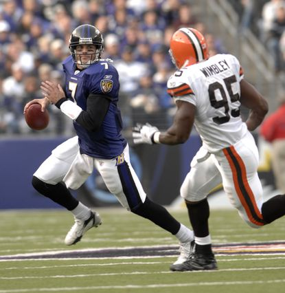 Ravens quarterback Kyle Boller scrambles away from the Browns in a 27-17 win in 2006.