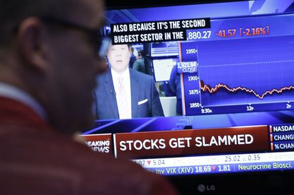 A trader monitors stock prices at the New York Stock Exchange, Friday, Jan. 15, 2016. U.S. stocks plunged again on Friday, completing the worst two-week start to a year ever.