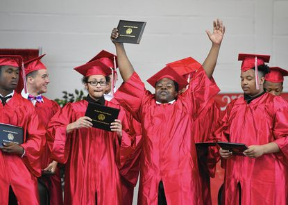 Christian Glasgow, center, and his classmates in the Class of 2016 celebrate graduating Friday morning from the Center for Educational Opportunity in Aberdeen.