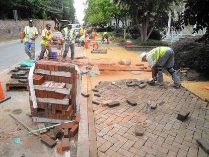 Historic preservation, brick by brick: City's sidewalk repairs need fix