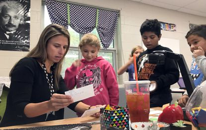 Teresa Beilstein goes over details students wrote for a writing prompt. Beilstein teaches third grade at South Shore Elementary School and was named Maryland Teacher of the Year last month.