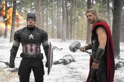 "This photo provided by Disney/Marvel shows, Chris Evans, left, as Captain America/Steve Rogers, and Chris Hemsworth as Thor, in a scene of the new film, ""Avengers: Age Of Ultron."" The movie releases in the U.S. on May 1, 2015. (Jay Maidment/Disney/Marvel via AP)"