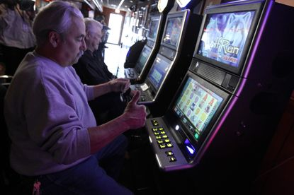 In this 2019 file photo, Dan Accardo plays video poker at Crabby's Pub in Stickney as the game went online in Illinois.
