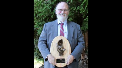 """Westminster resident Jim Arnett was recently inducted into the Maryland Senior Citizens Hall of Fame and was awarded the Geri Award he is shown holding, which is given to a maximum of five person per year for """"extraordinary humanitarian community service."""""""