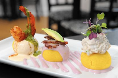 Puerto 511's Causa Sampler: Peruvian potato bites with, from left, shrimp in anticucho sauce, grilled octopus in Botija sauce with avocado and Aji Amarillo white tuna
