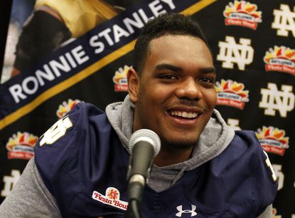 Notre Dame offensive lineman Ronnie Stanley speaks with reporters during media day for the Fiesta Bowl NCAA college football game, Wednesday, Dec. 30, 2015, in Scottsdale, Ariz.