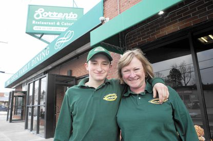 At the family owned restaurant Sorrento of Arbutus, owner Ella Kostinsky and her son, Brandon, had differing views on what a change in minimum wage across the border could bring.